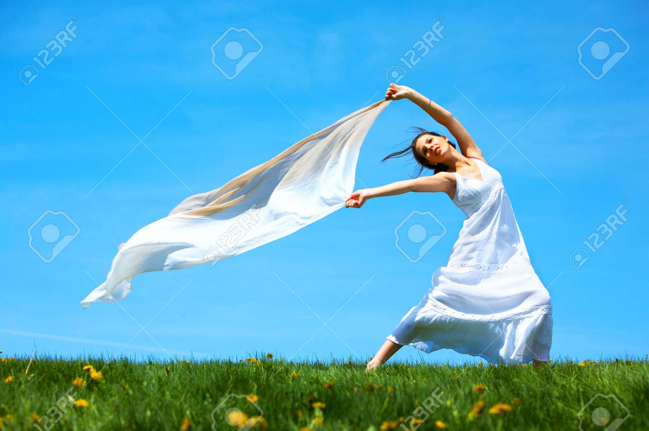 Freedom. Happy young woman running  in the field Stock Photo - 3584345