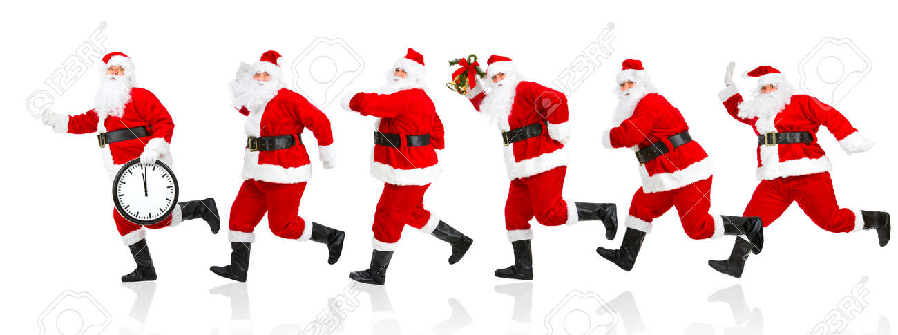 Happy running Christmas Santas. Isolated over white background Stock Photo - 3805121