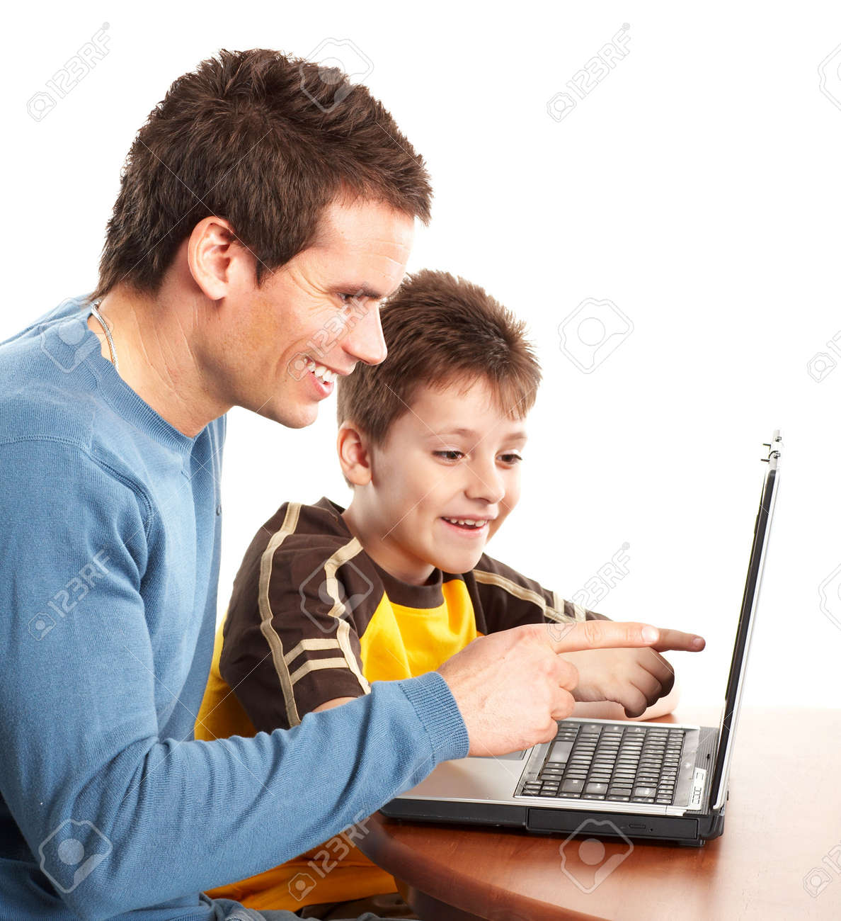 Happy family. Father and boy working with laptop. Over white background Stock Photo - 4752416