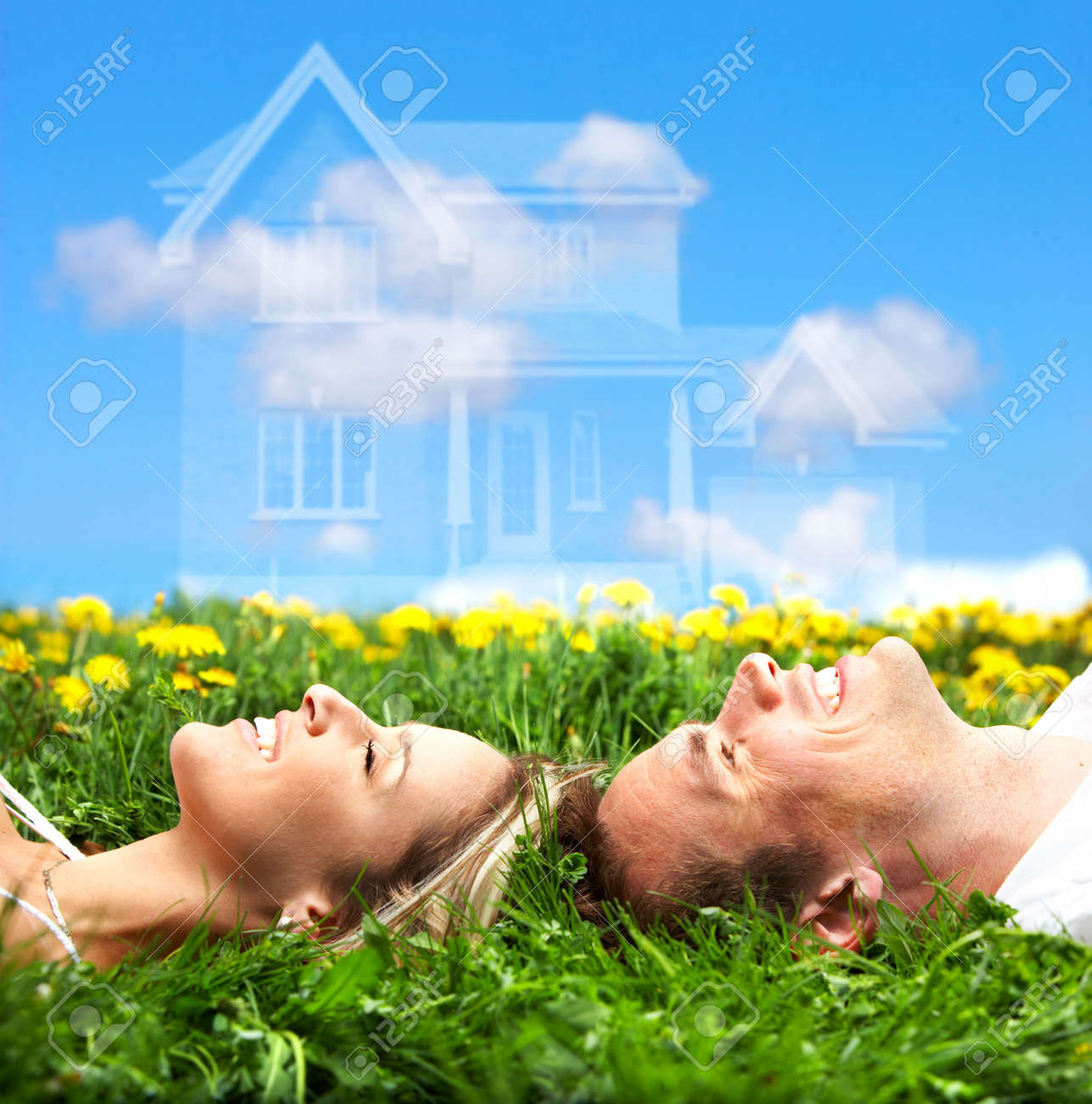 Young love couple smiling dreaming about a new home.  Real estate concept Stock Photo - 4808161