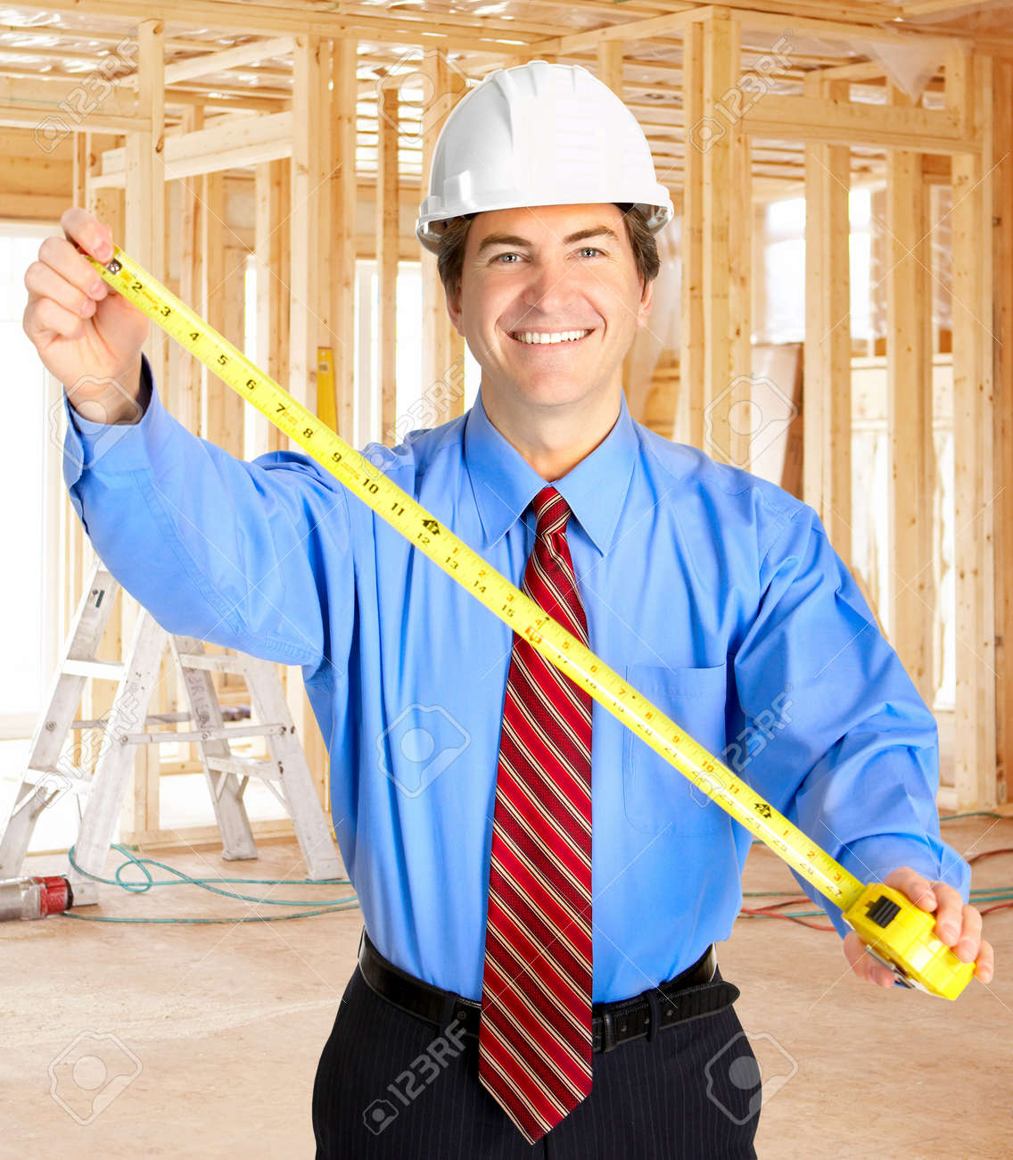 Mature handsome smiling architect with a tape Stock Photo - 4823404
