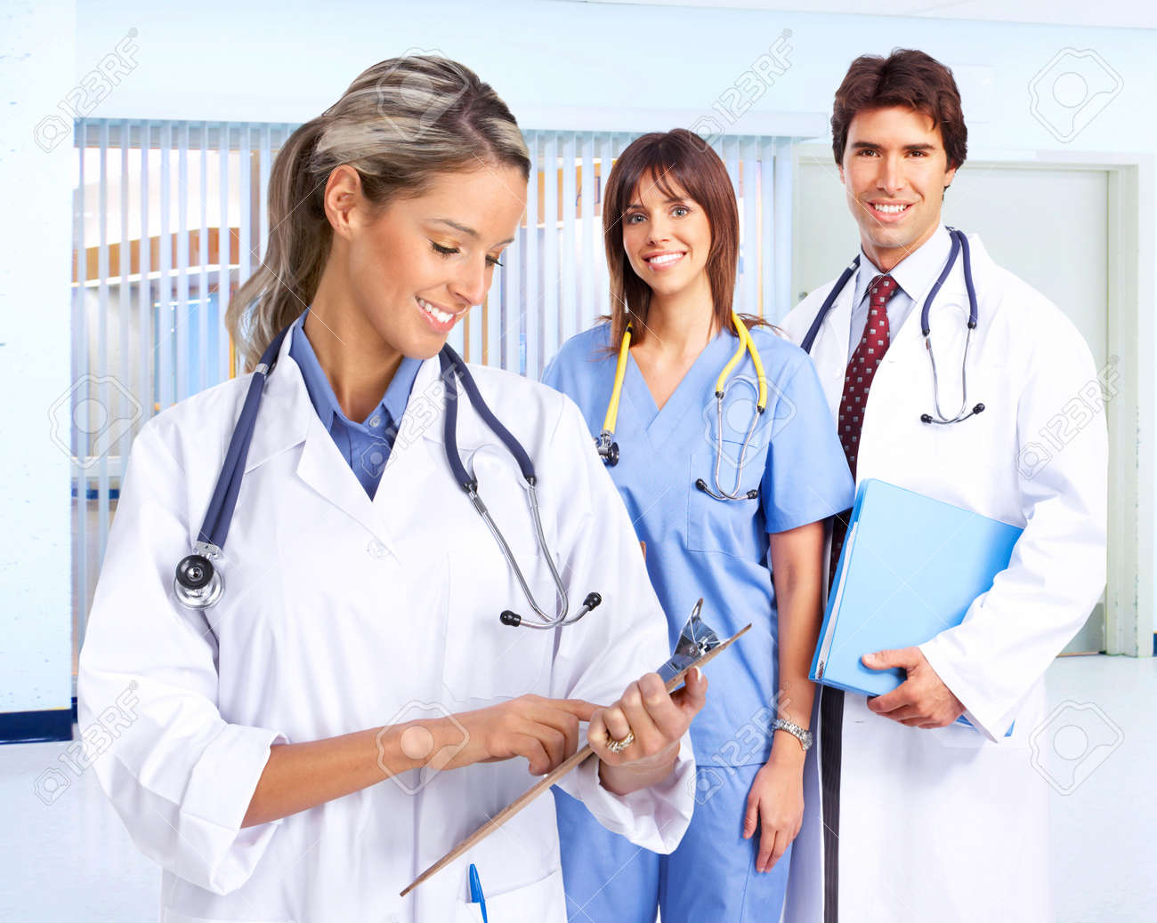 Smiling medical people with stethoscopes. Doctors and nurses Stock Photo - 4823396
