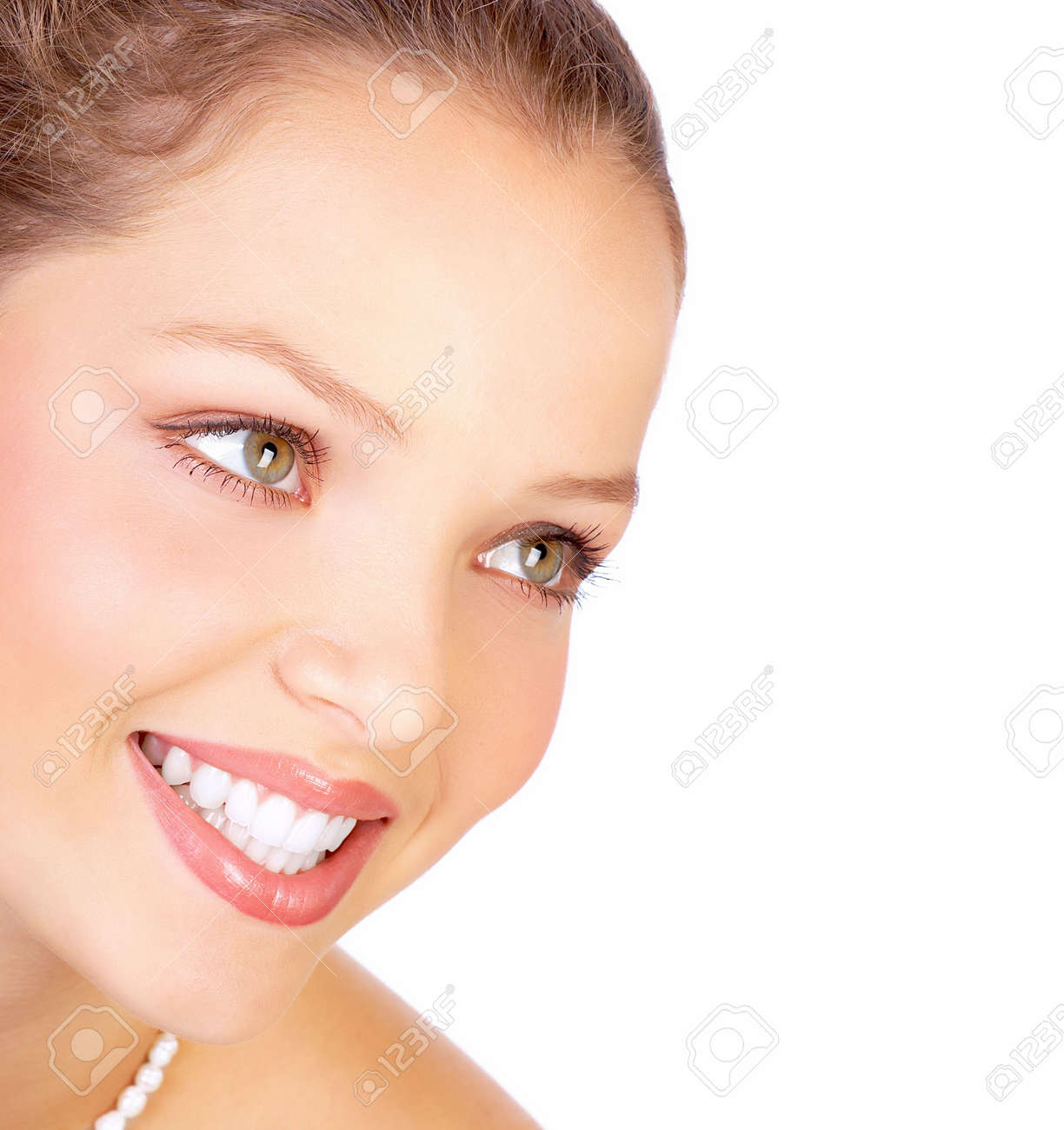 Beautiful young smiling woman. Isolated over white  background Stock Photo - 4939464