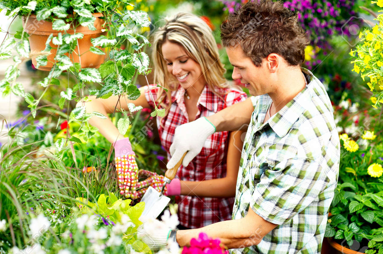 Young smiling people florists working in the garden Stock Photo - 4939679