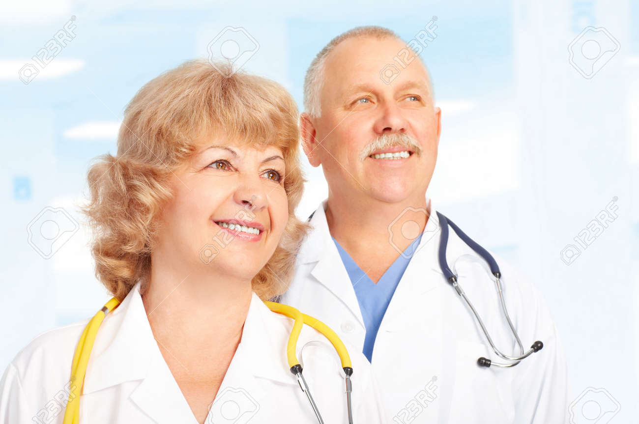 Smiling medical doctors with stethoscope. Over blue background Stock Photo - 5461548