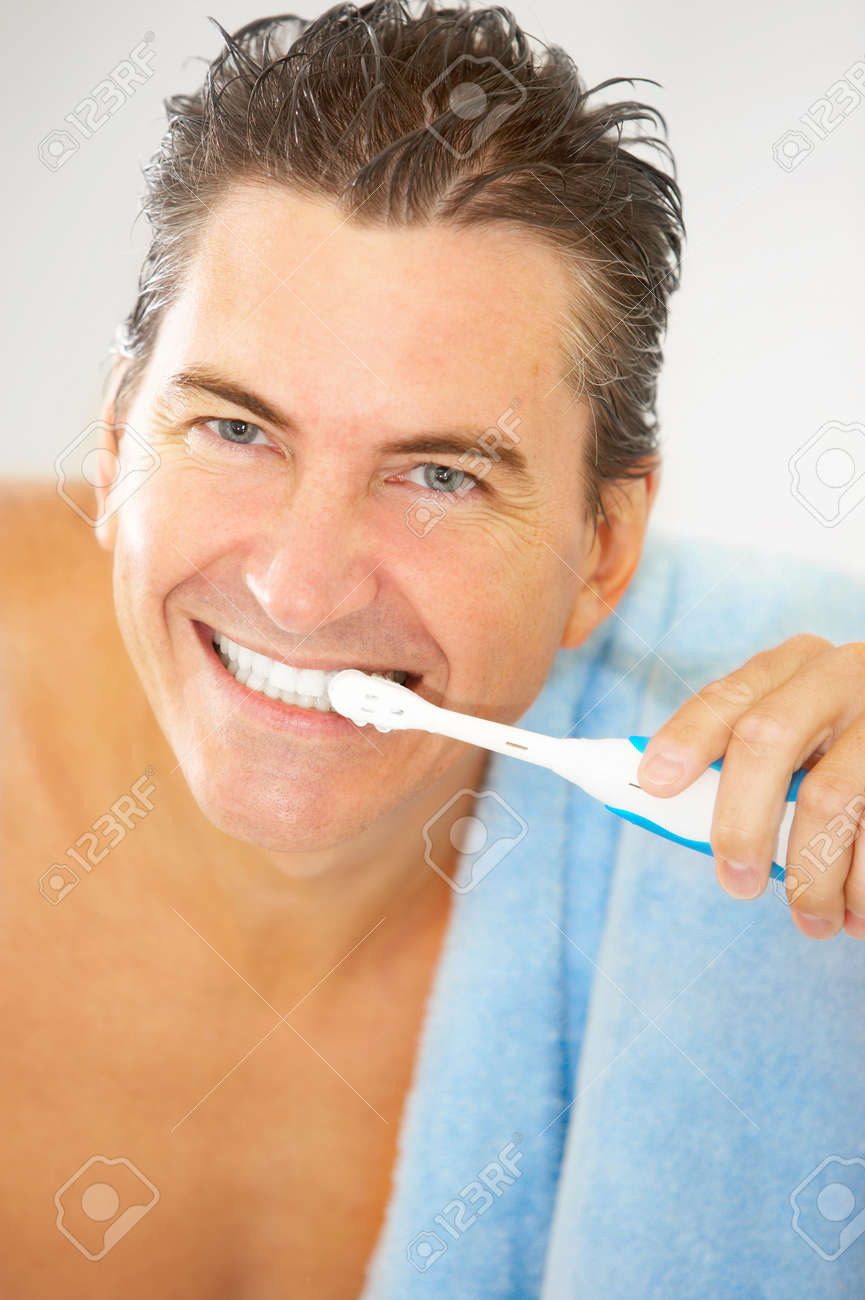 Smiling handsome man in the bathroom Stock Photo - 5487288