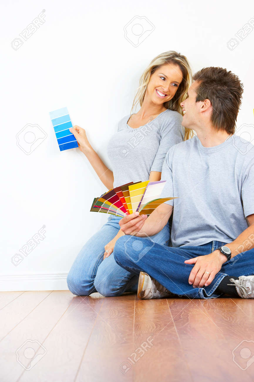 smiling couple choosing color for the  interior wall of home. Stock Photo - 5525668
