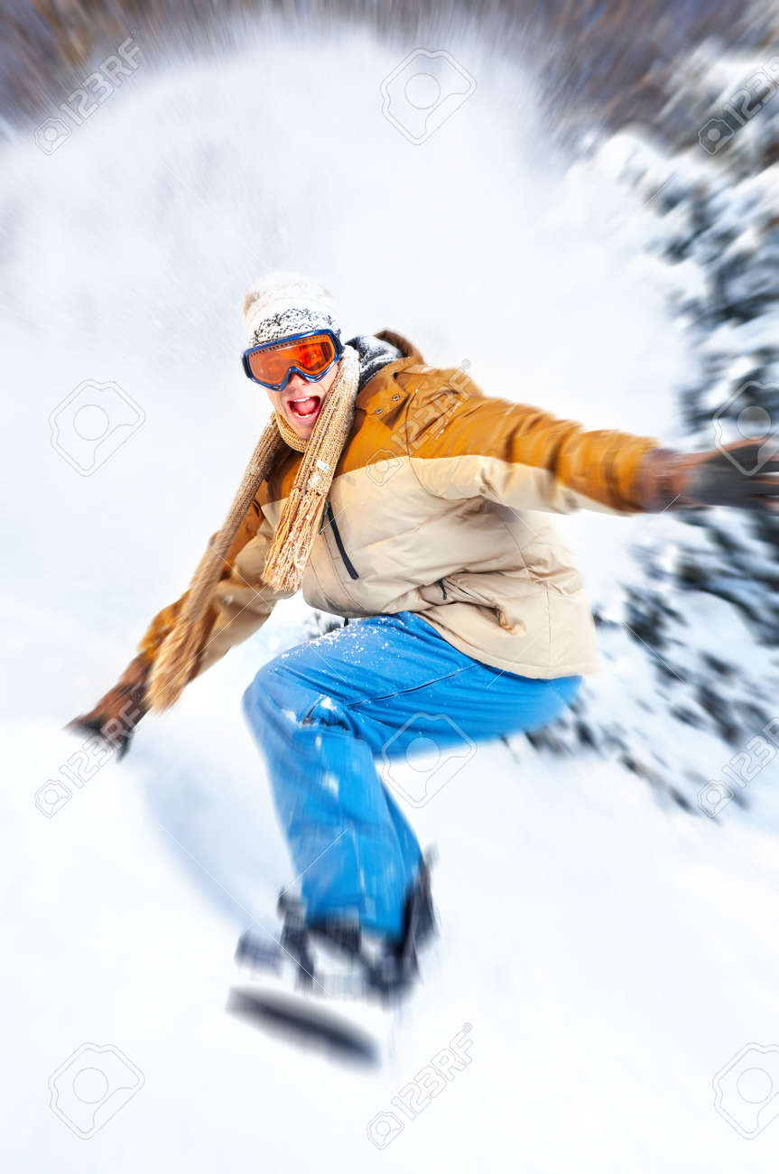 Young  happy smiling man with snowboard. Winter sport Stock Photo - 5572268