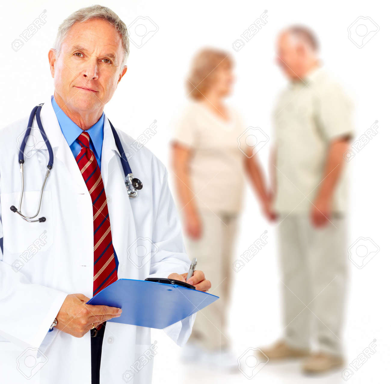 Smiling medical doctor with stethoscope and elderly couple Stock Photo - 5713452