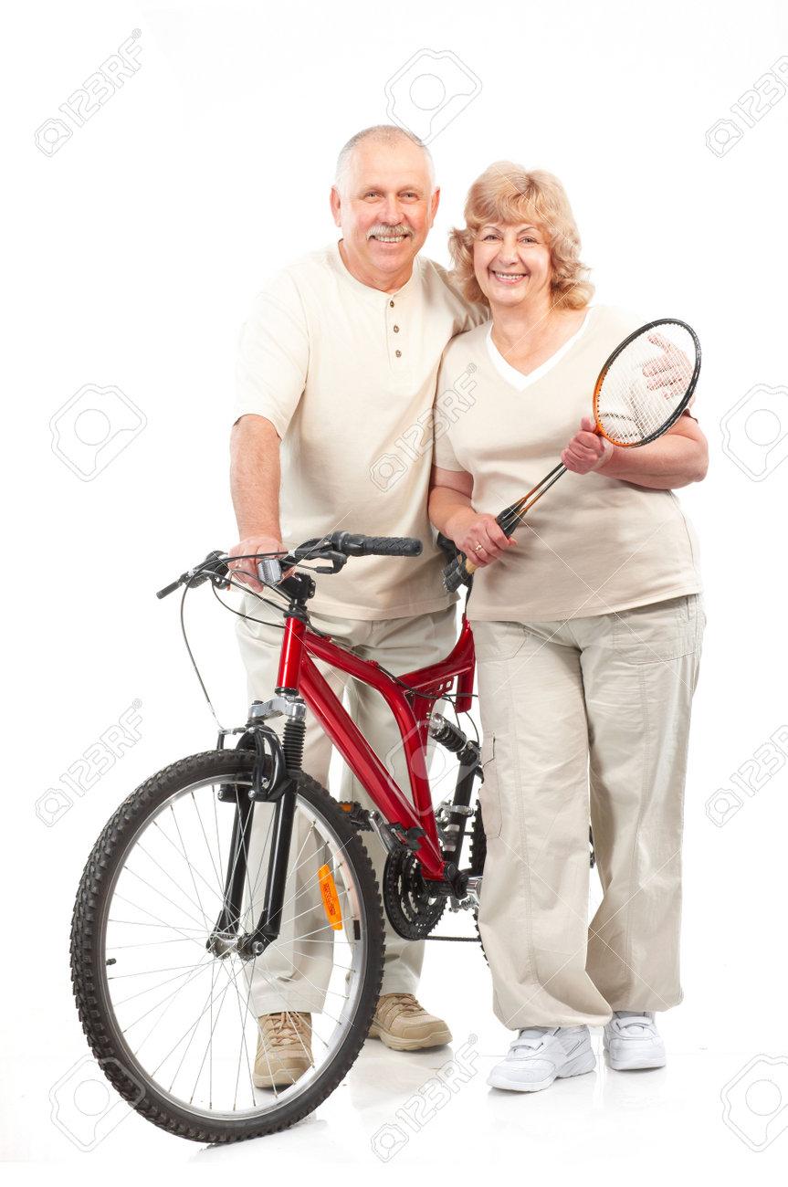 Active elderly couple. Isolated over white background Stock Photo - 5720321
