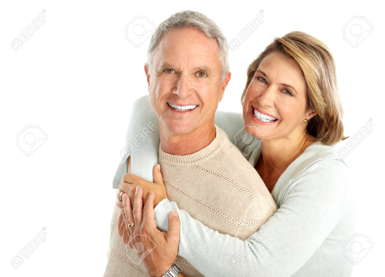 Happy elderly couple in love. Isolated over white background Stock Photo - 5770920