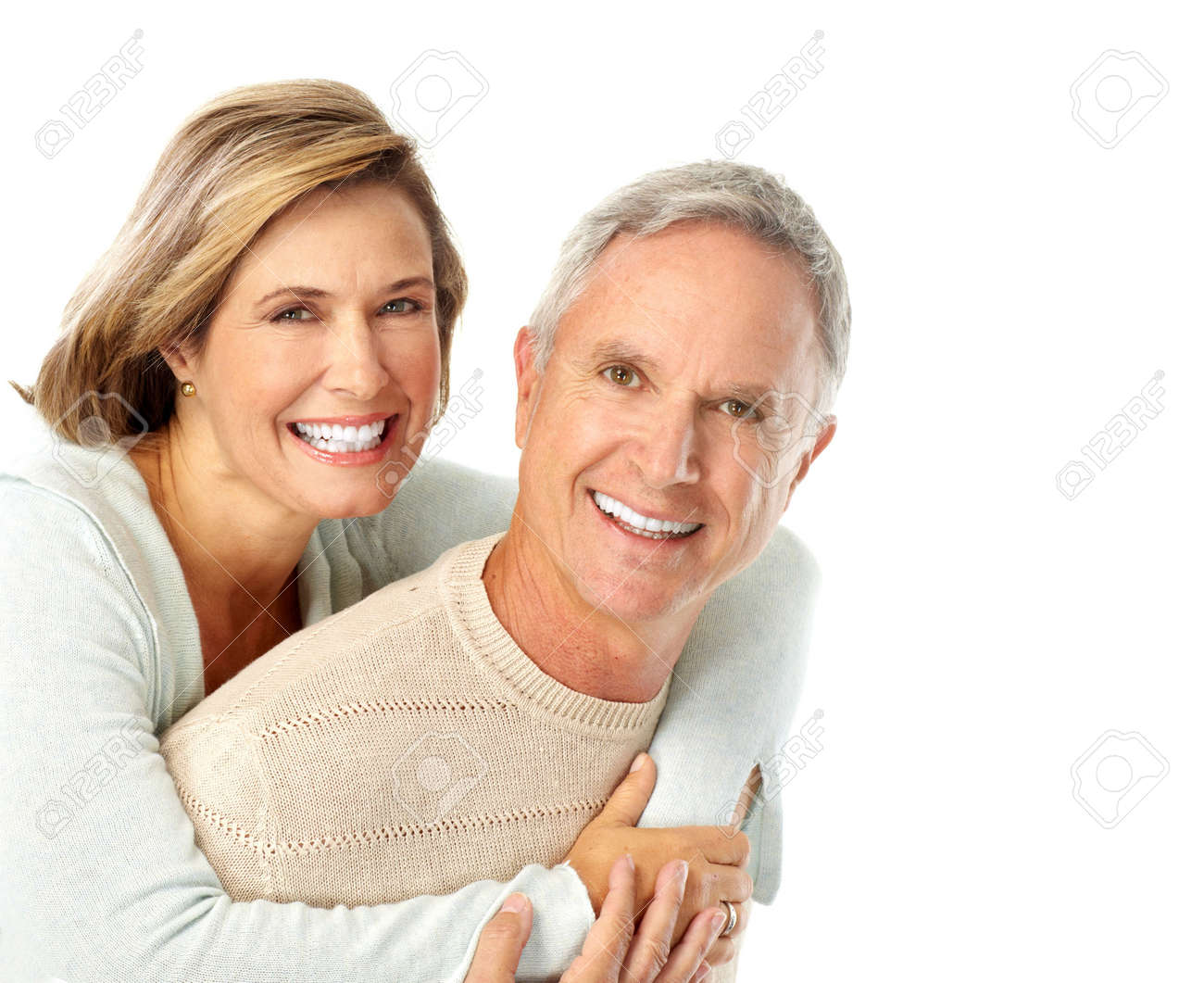 Happy elderly couple in love. Isolated over white background Stock Photo - 5813156