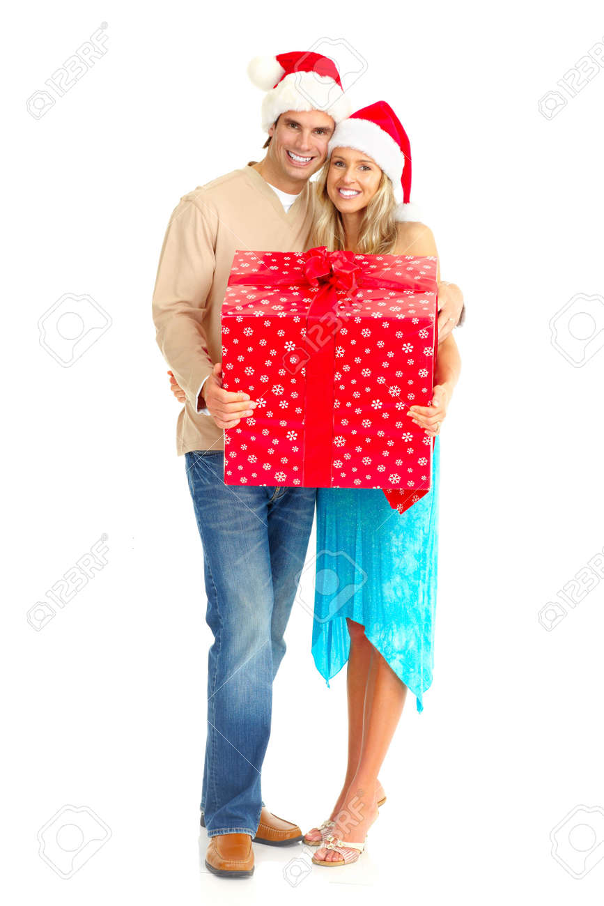 Young happy couple near  a Christmas tree. Isolated over white background Stock Photo - 5955291