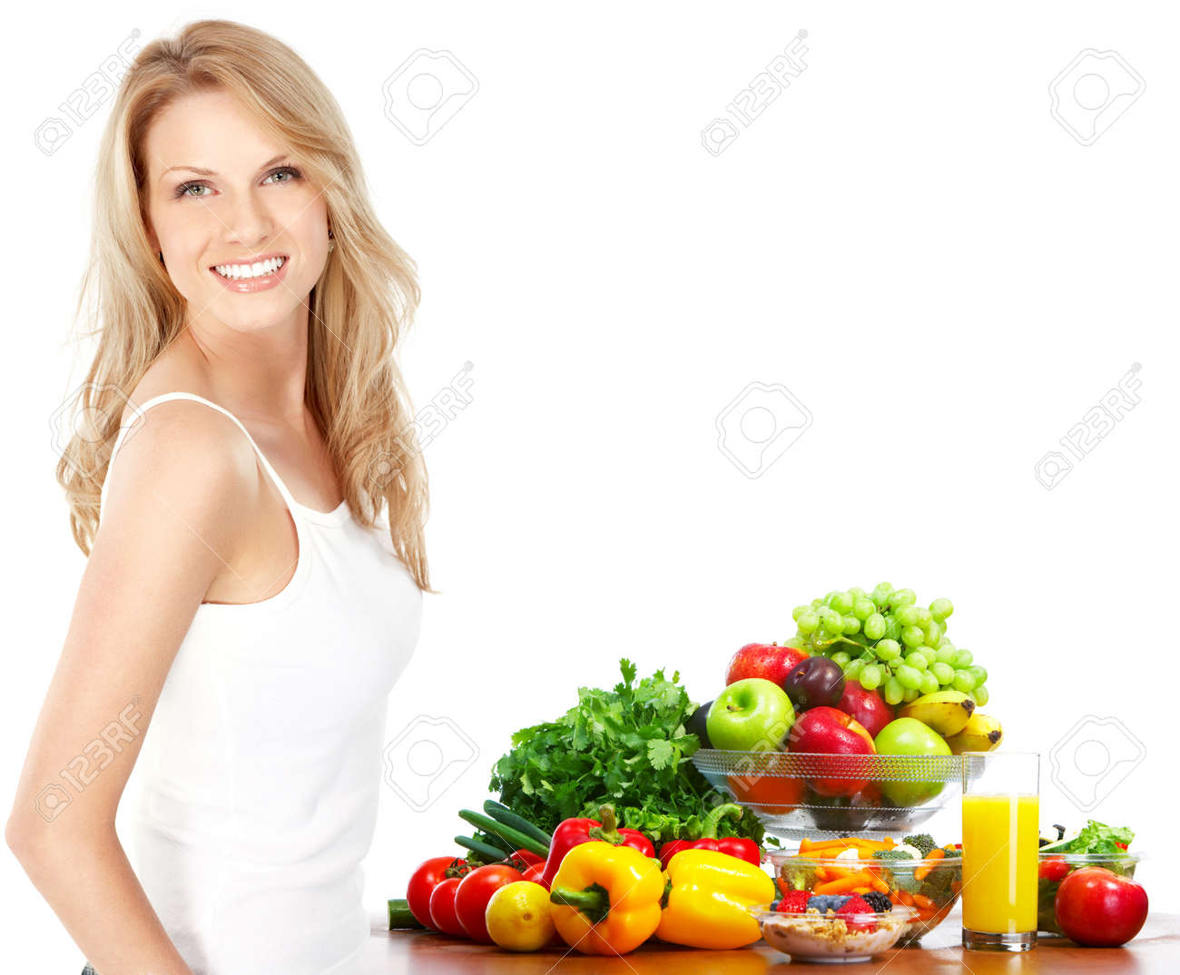 Young smiling woman  with fruits and vegetables. Over white background Stock Photo - 6024156
