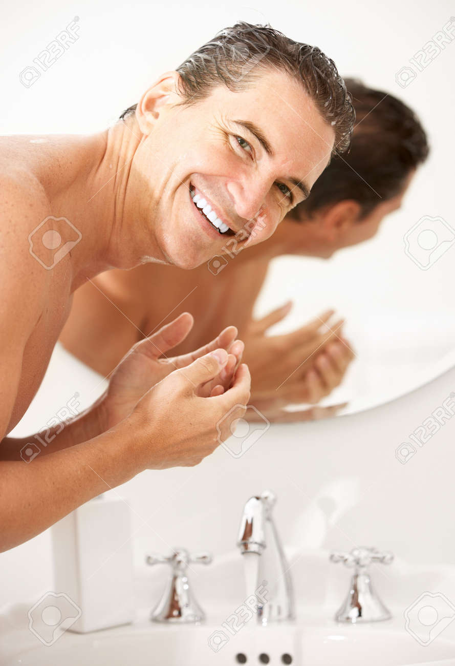 handsome man washing in the bathroom Stock Photo - 6069846