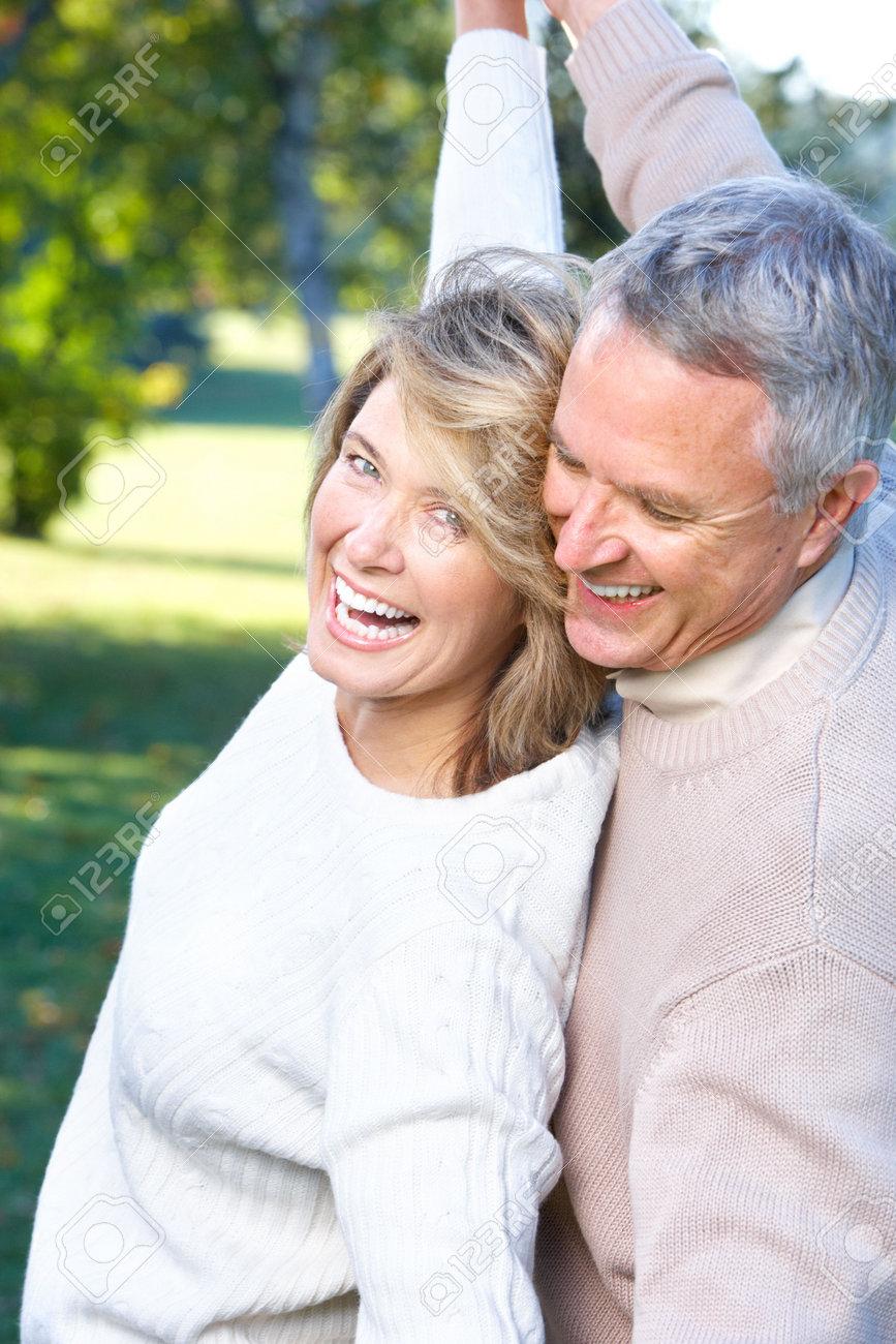 Happy elderly seniors couple in park Stock Photo - 6116068