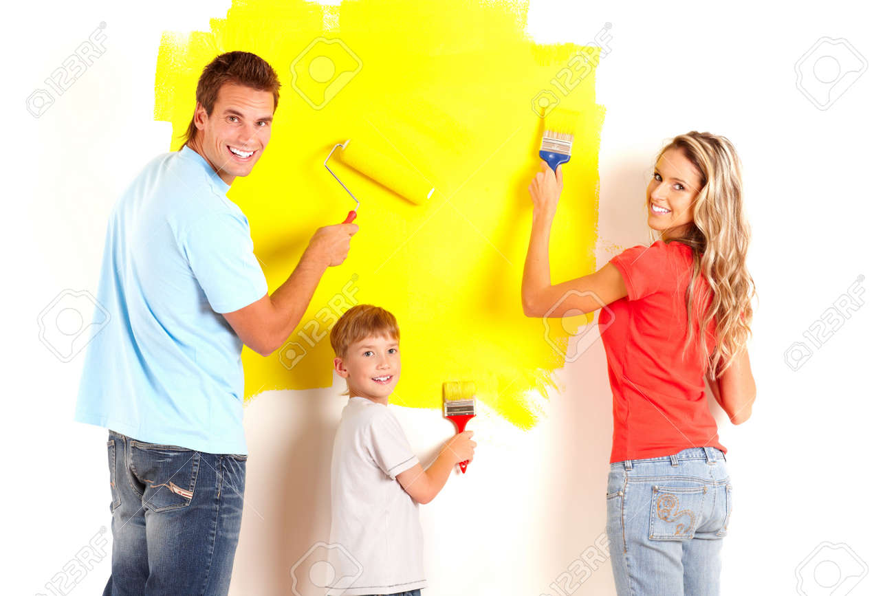 Renovation. Young family painting interior wall of home. Stock Photo - 6184396