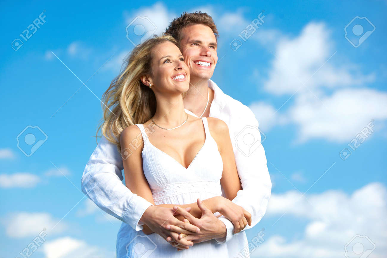 Young love couple smiling under blue sky Stock Photo - 6184397