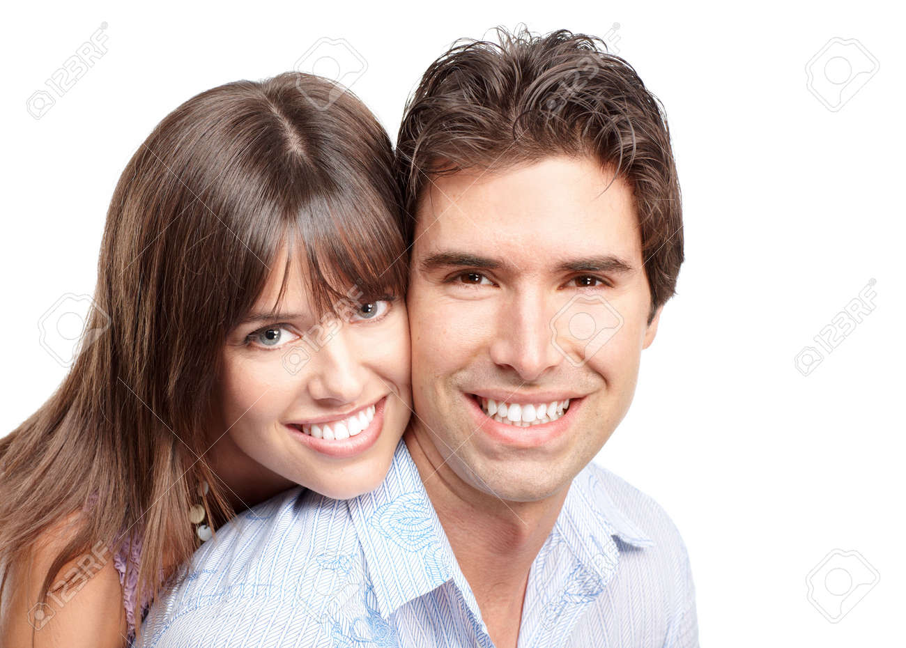 Happy smiling couple in love. Over white background Stock Photo - 6387382