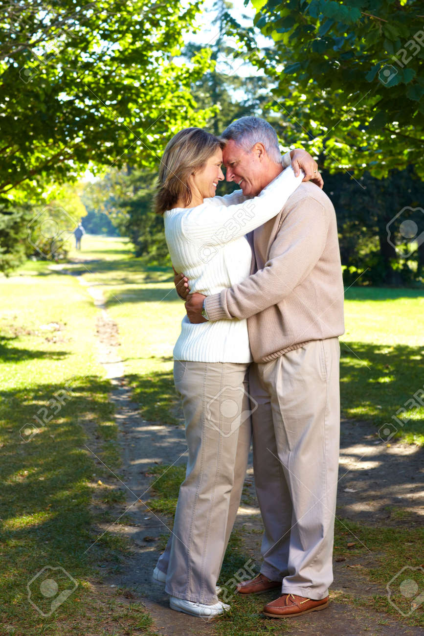 Happy elderly seniors couple in park Stock Photo - 6387383