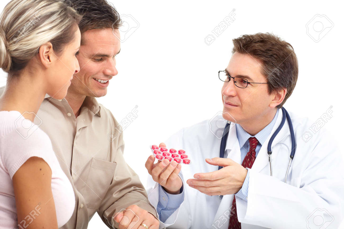 Medical doctor and young couple patients. Isolated over white background Stock Photo - 6387240