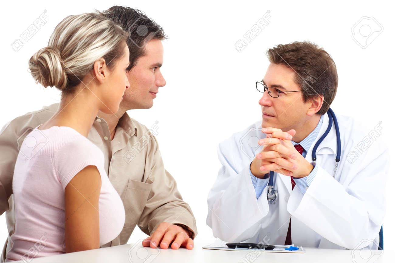 Medical doctor and young couple patients. Isolated over white background Stock Photo - 6387305