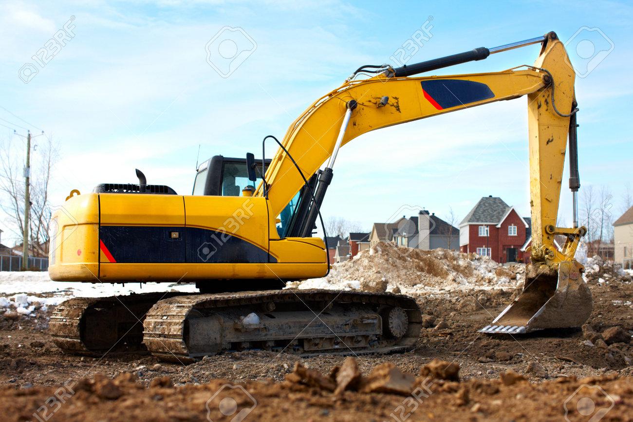 Yellow excavator, construction. Stock Photo - 6424045