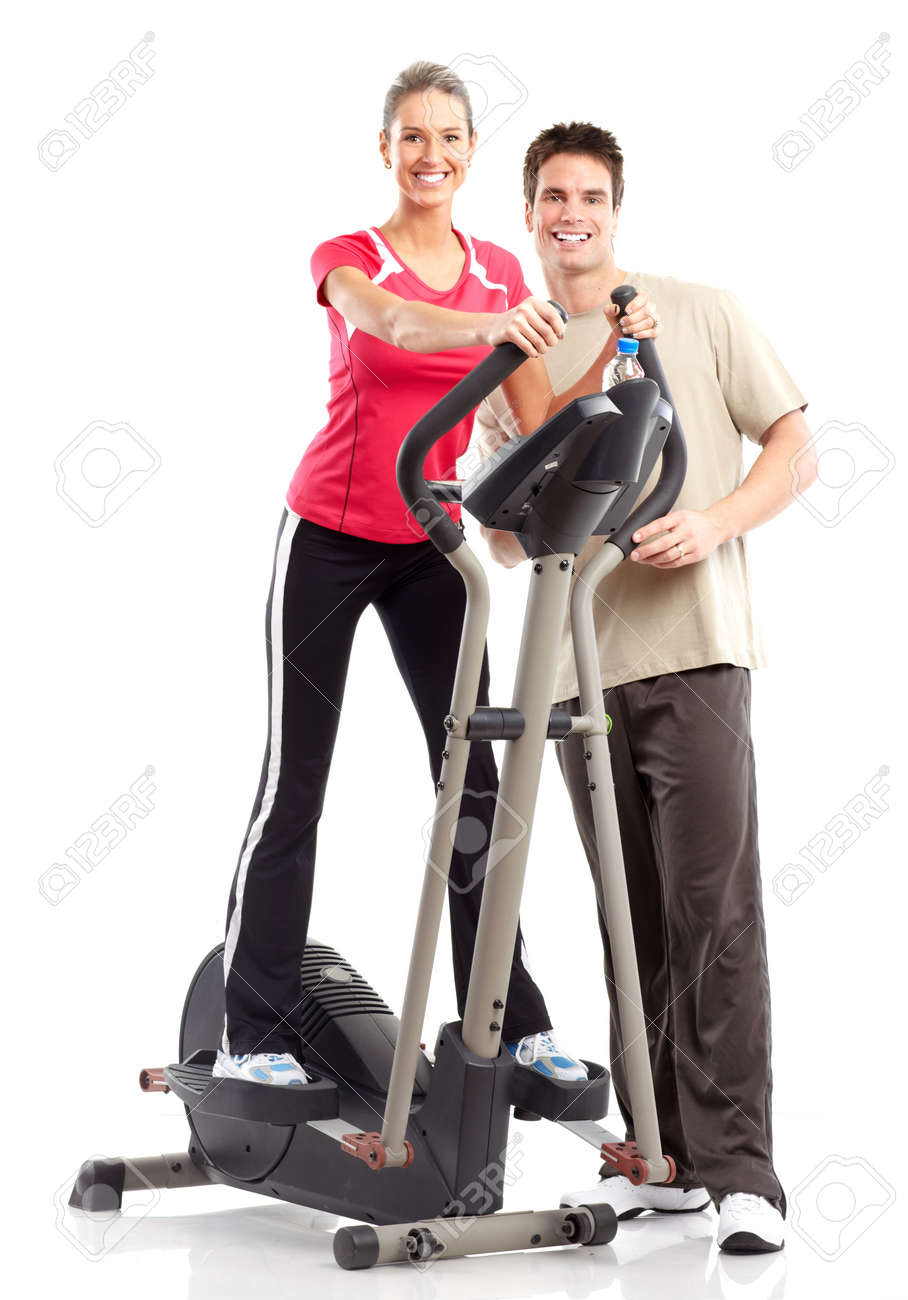 Gym & Fitness. Smiling young woman working out. Isolated over white background Stock Photo - 6423959