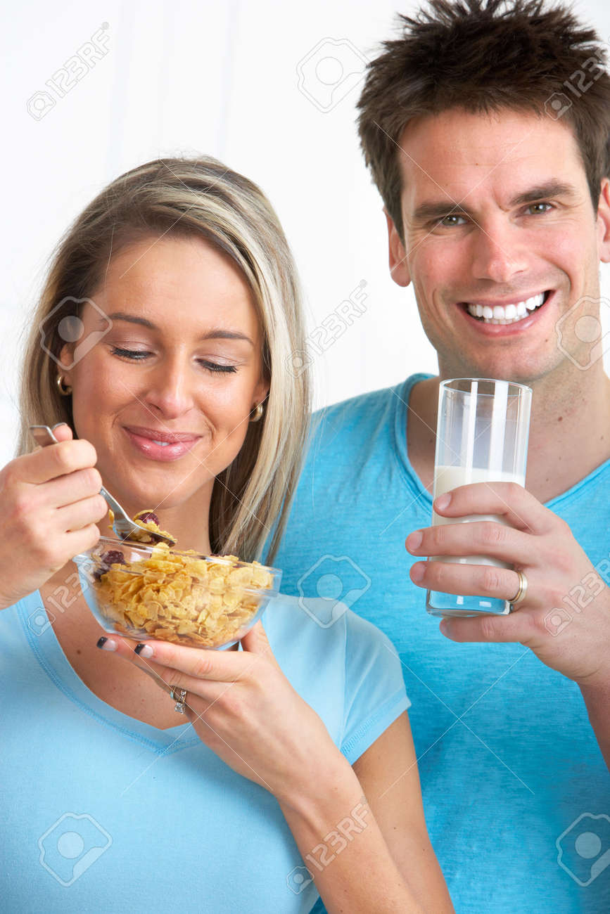 Young smiling couple having lunch at home Stock Photo - 6424037