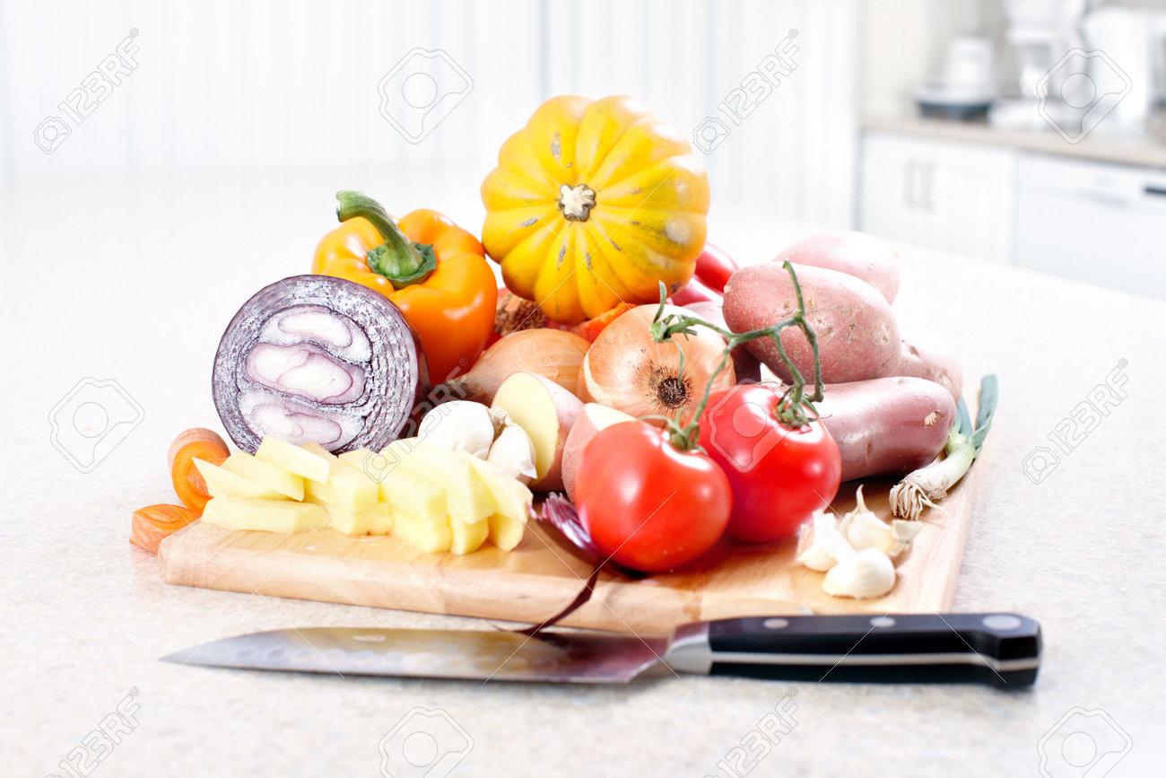 photo kitchen cooking potato knife cutting board table kitchen cutting table Kitchen cooking potato knife cutting board table Stock Photo