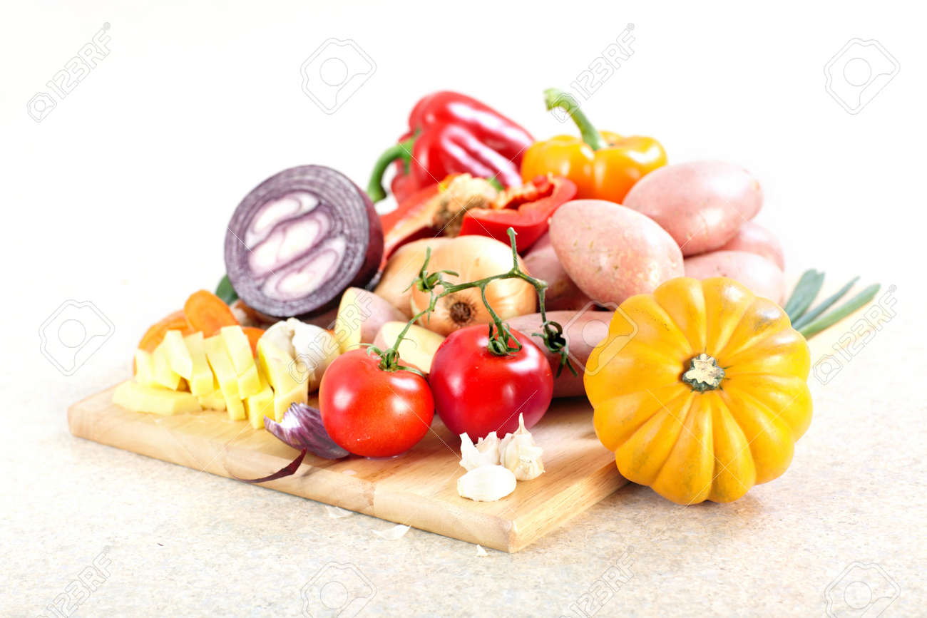 6468770 Kitchen vegetables cooking potato knife cutting board table Stock Photo