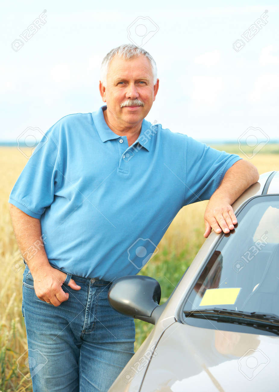 Smiling happy elderly senior  man  near the new car Stock Photo - 6509753