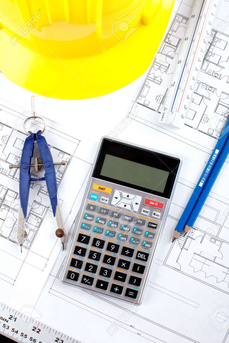 pencil and calculator over a construction drawing of a house stock stock photo pencil and calculator over a construction drawing of a house
