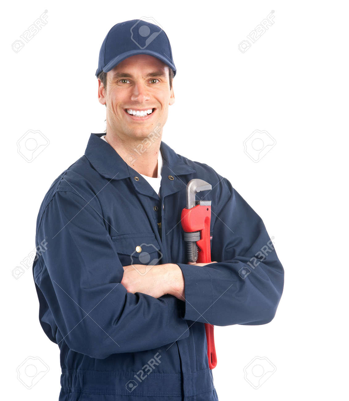 Young handsome plumber worker with adjustable wrench. Isolated over white background Stock Photo - 6607994