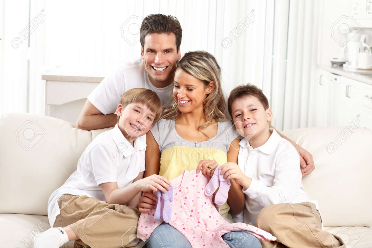 Smiling beautiful pregnant mother and family  at home Stock Photo - 12137518