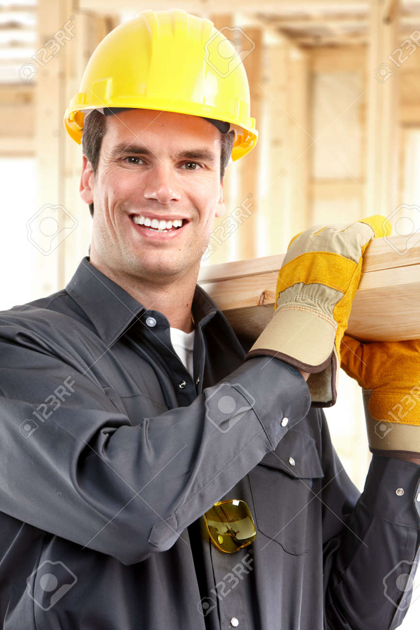 Young handsome builder with wood planks Stock Photo - 6637718
