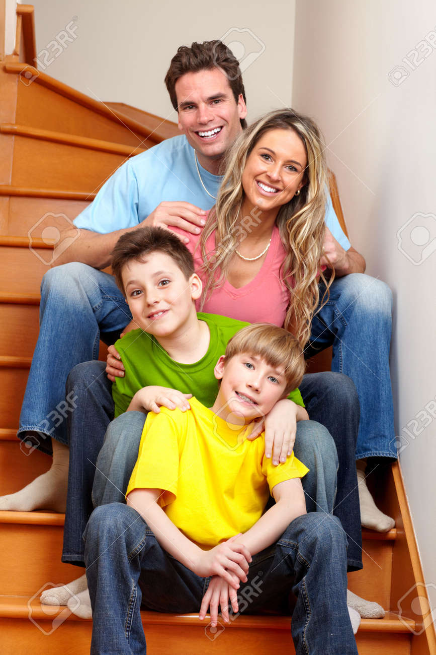 Happy family. Father, mother and boys at home Stock Photo - 12137541