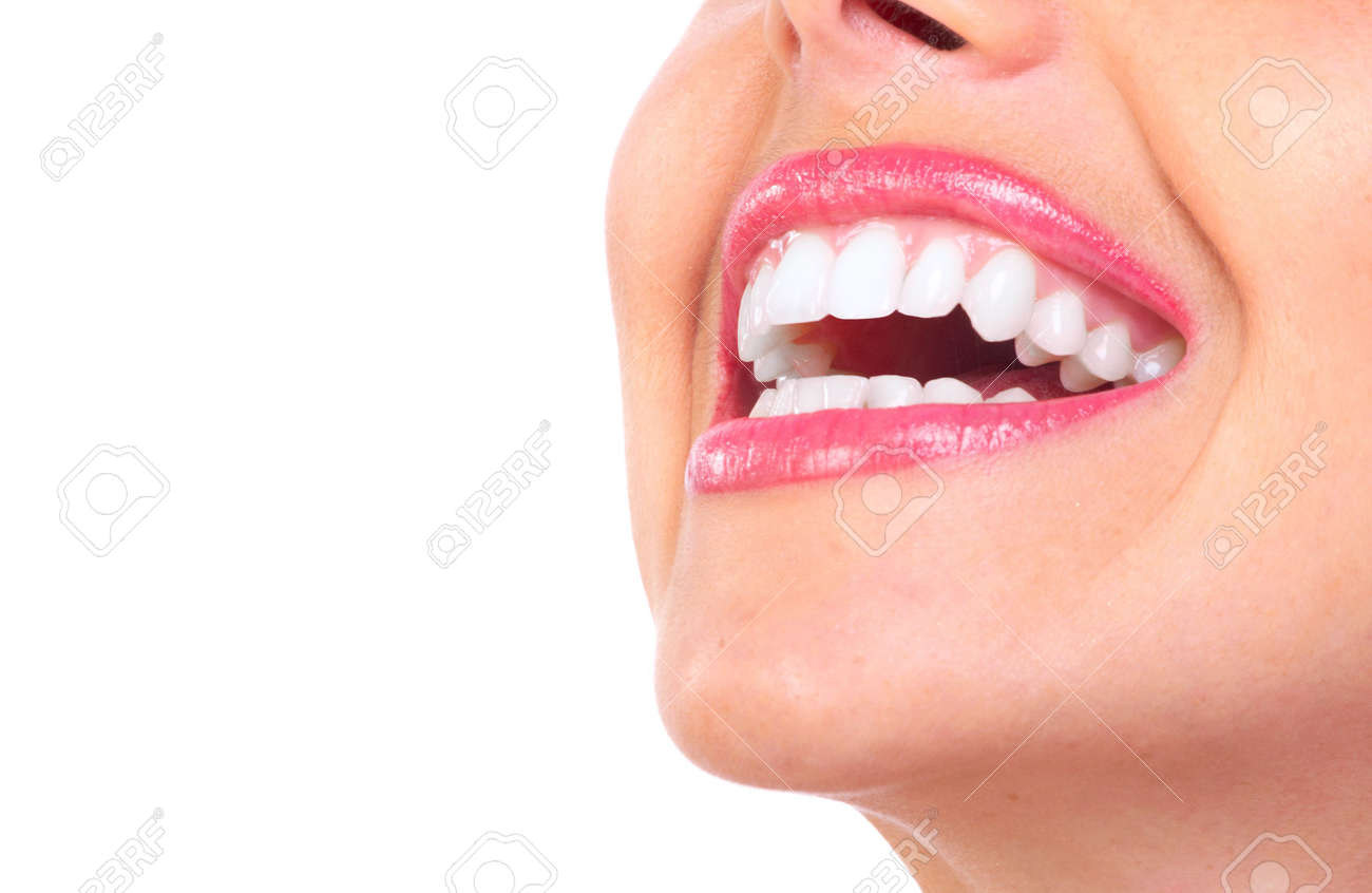 Beautiful young woman teeth. Isolated over white background - 6732744