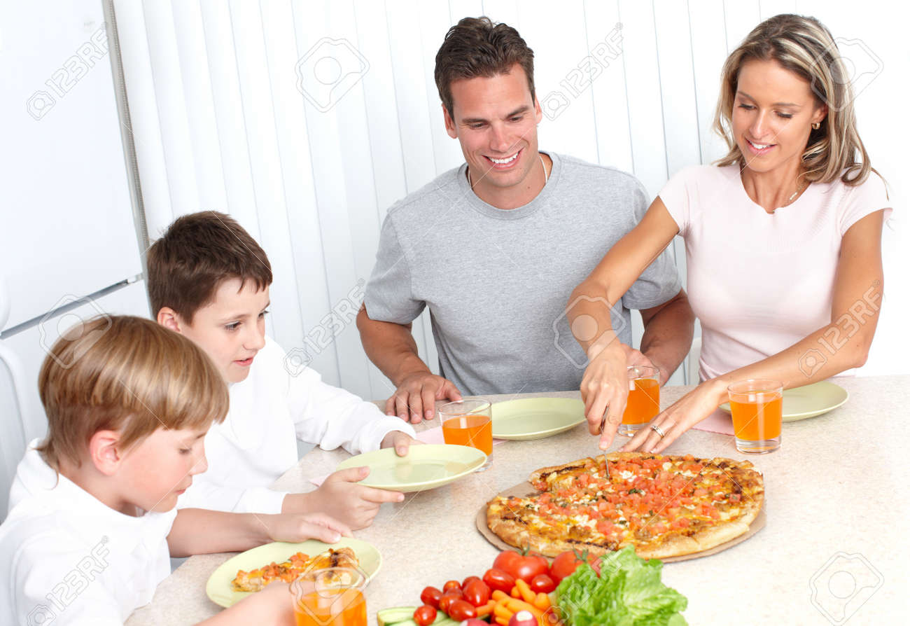 Family pizza . Father, mother and children eating a big pizza Stock Photo - 7088180