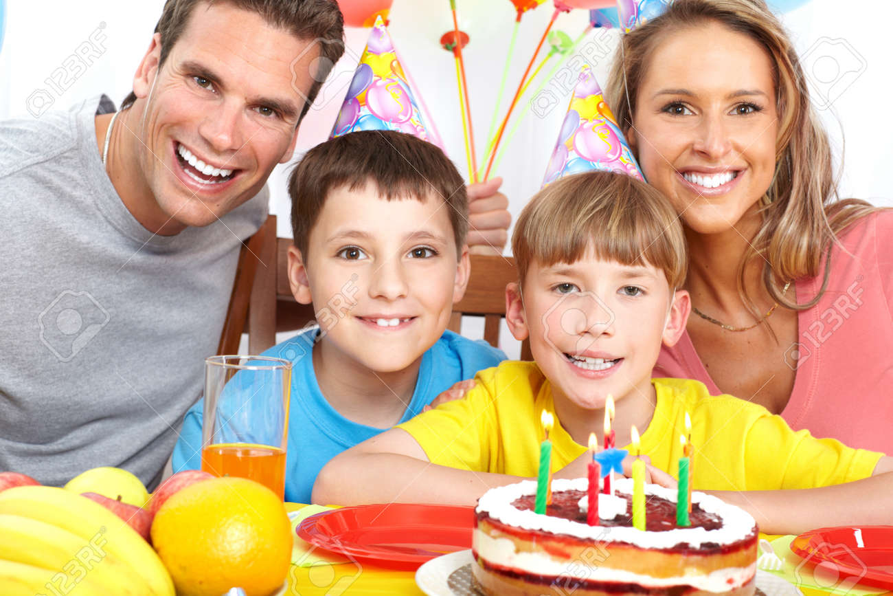 Happy family . Father, mother and children celebrating birthday at home Stock Photo - 7088203