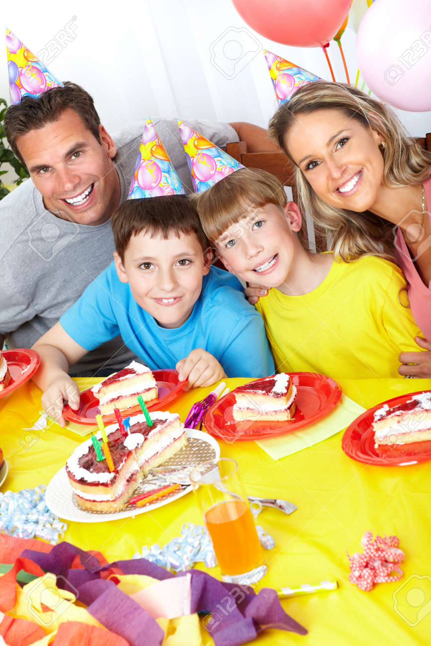 Happy family . Father, mother and children celebrating birthday at home Stock Photo - 7088262