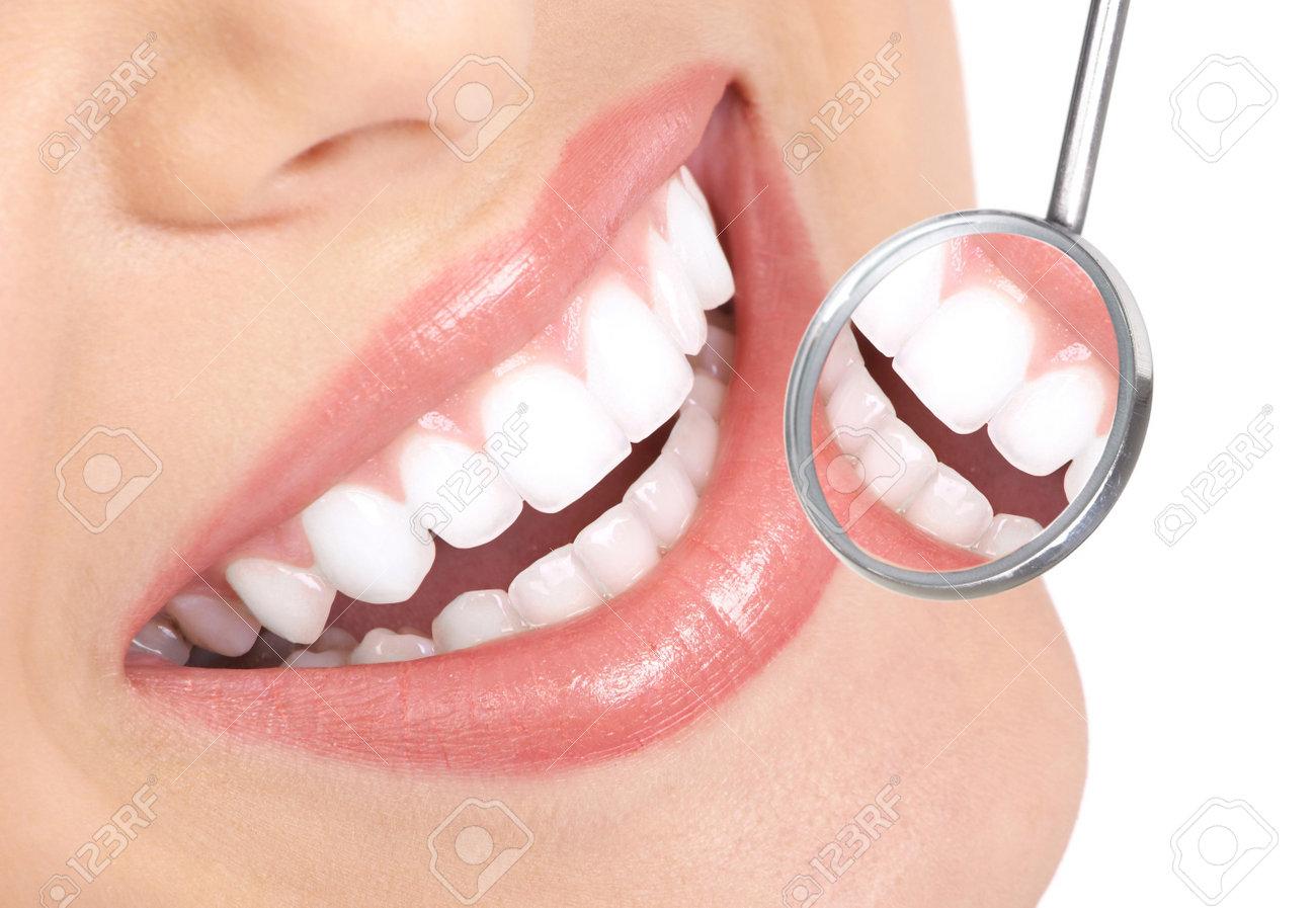 Healthy woman teeth and a dentist mouth mirror - 7169697