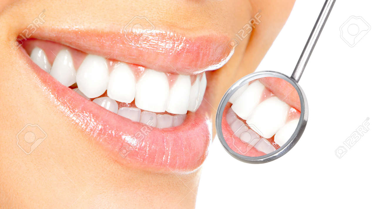 Healthy woman teeth and a dentist mouth mirror Stock Photo - 7169700