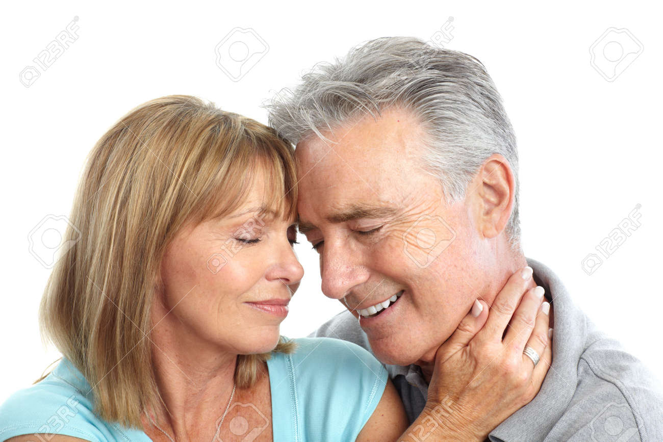 Happy elderly seniors couple in love. Isolated over white background Stock Photo - 7231988