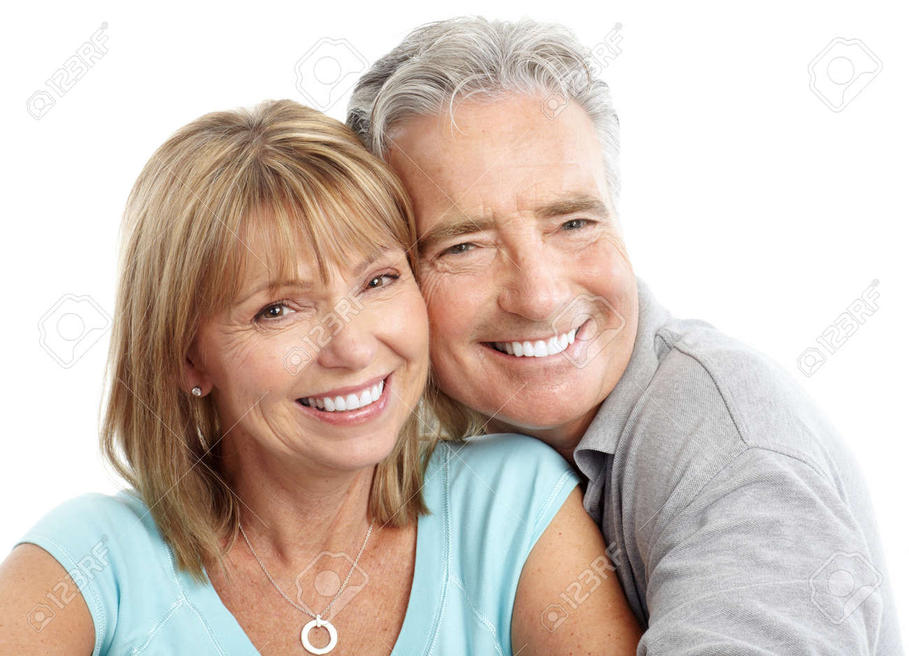 Happy seniors couple in love. Healthy teeth. Isolated over white background Stock Photo - 7231973