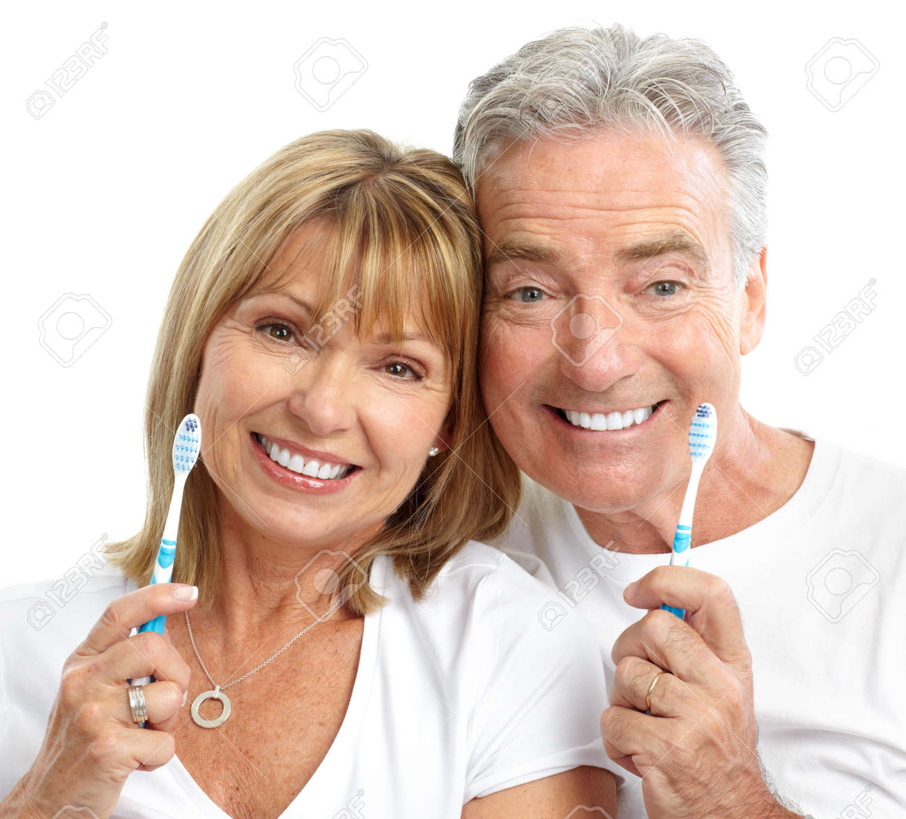 Happy seniors couple with toothbrushes. Healthy teeth. Isolated over white background Stock Photo - 7231944