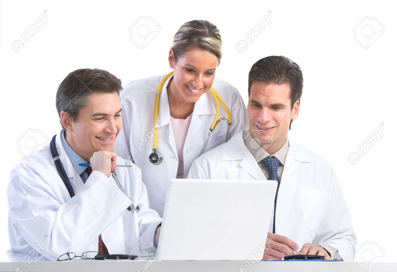 Smiling medical doctors working with a laptop computer. Isolated over white background Stock Photo - 7303869