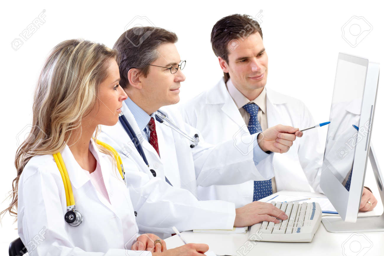 Smiling medical doctors working with a computer. Isolated over white background Stock Photo - 7317208