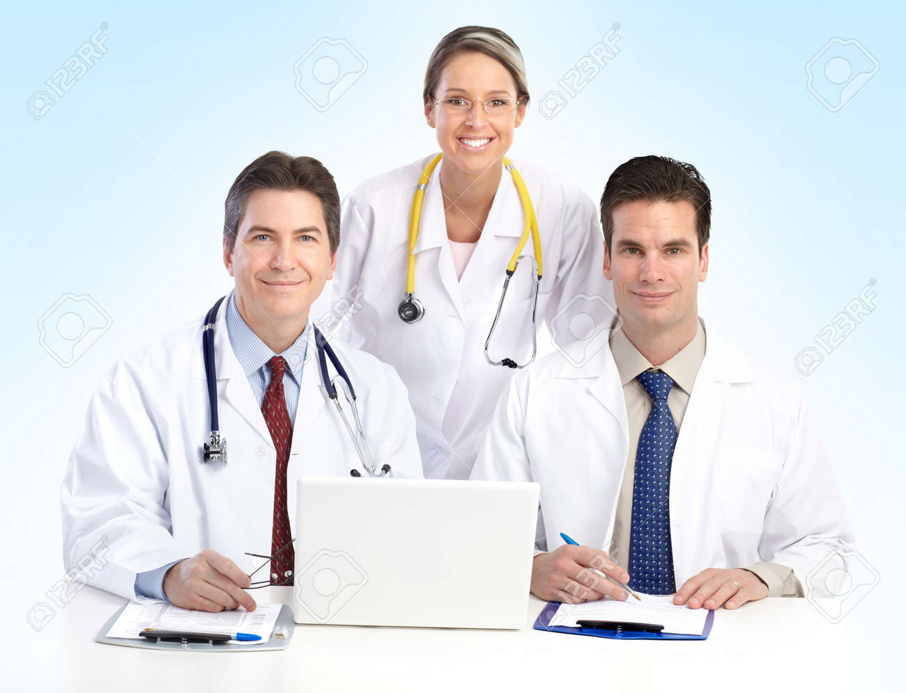 Smiling medical doctors with stethoscopes working with computer. Stock Photo - 7303888