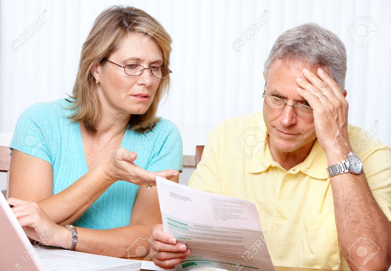 Senior couple  working with laptop at home Stock Photo - 7365003